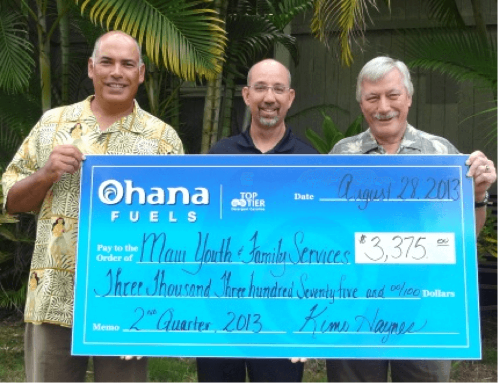 Maui Petroleum President Kimo Haynes (left) and General Manager Steve Wetter (center) present a check to MYFS Chief Executive Officer Judd Cunningham (right)